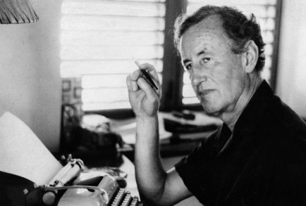 Ian Fleming at his desk at Goldeneye, Jamaica